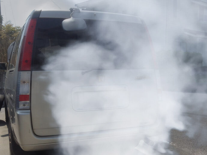 What causes black or white smoke to come from a diesel car's