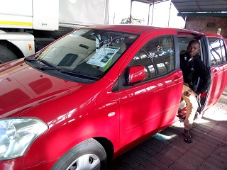 Customer who purchased a car from TRUST CO., LTD .
